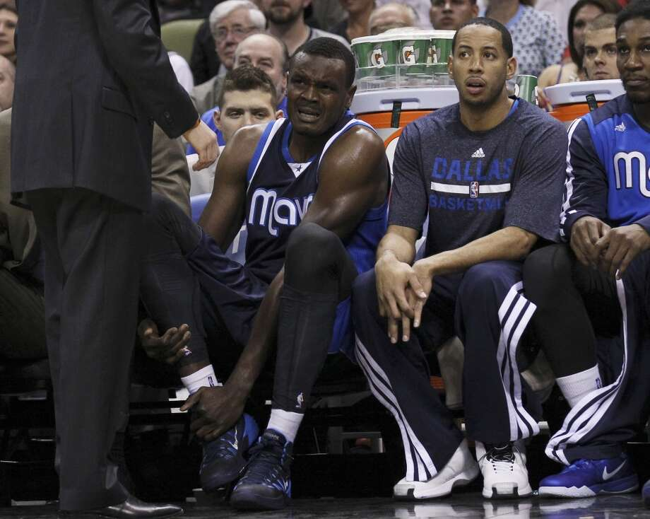 Dallas Mavericks' Samuel Dalembert (01) sits on the bench in pain after colliding with Spurs' Danny Green (04) in the first half of Game 5 of the first round of the Western Conference playoffs at the AT&T Center on Wednesday, Apr. 30, 2014. Photo: Kin Man Hui, San Antonio Express-News