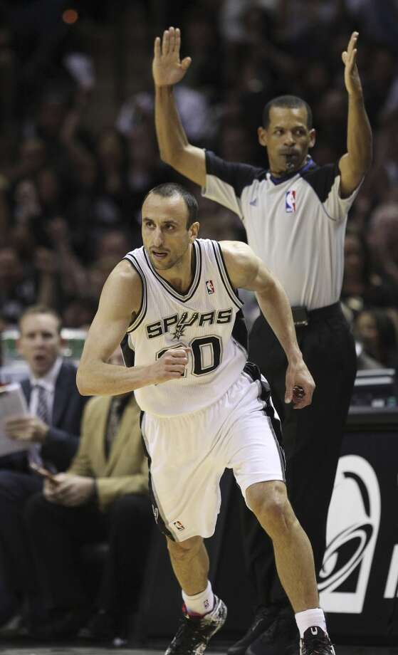Spurs' Manu Ginobili (20) runs up court after sinking a three against the Dallas Mavericks in the first half of Game 5 of the first round of the Western Conference playoffs at the AT&T Center on Wednesday, Apr. 30, 2014. Photo: Kin Man Hui, San Antonio Express-News