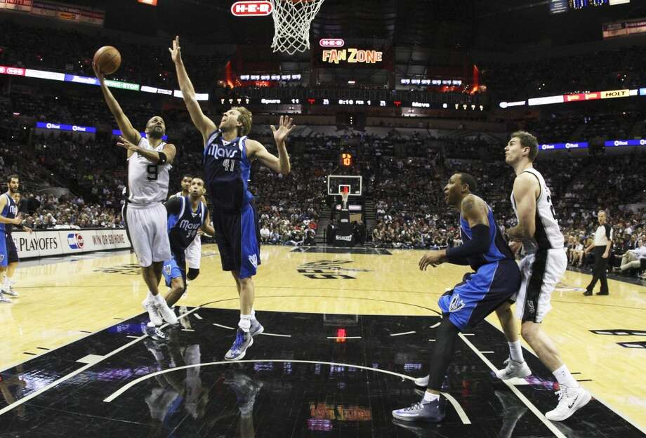 Spurs' Tony Parker (09) attempts a shot against Dallas Mavericks' Dirk Nowitzki (41) in the first half of Game 5 of the first round of the Western Conference playoffs at the AT&T Center on Wednesday, Apr. 30, 2014. Photo: Kin Man Hui, San Antonio Express-News