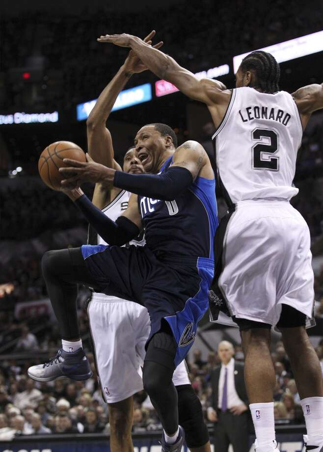 Dallas Mavericks' Shawn Marion (00) attempts a shot between Spurs' Tim Duncan (21) and Kawhi Leonard (02) in the first half of Game 5 of the first round of the Western Conference playoffs at the AT&T Center on Wednesday, Apr. 30, 2014. Photo: Kin Man Hui, San Antonio Express-News