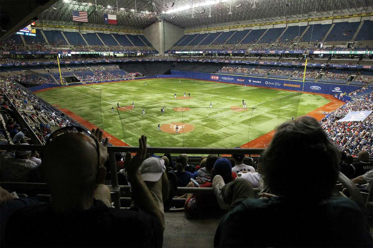 Baseball fans attend the Big League Weekend Major League Baseball exhibition game between the Houston Astros and the Texas Rangers at the Alamodome on Saturday, Mar. 29, 2014.