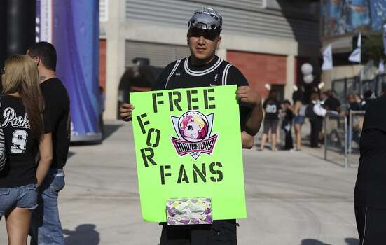 Spurs fan Juan Ramirez holds up a humorous poster before entering the AT&T Center before Game 2 of the first round of the Western Conference playoffs between the Spurs and the Dallas Mavericks on Wednesday, April 23, 2014. Photo: Kin Man Hui, San Antonio Express-News