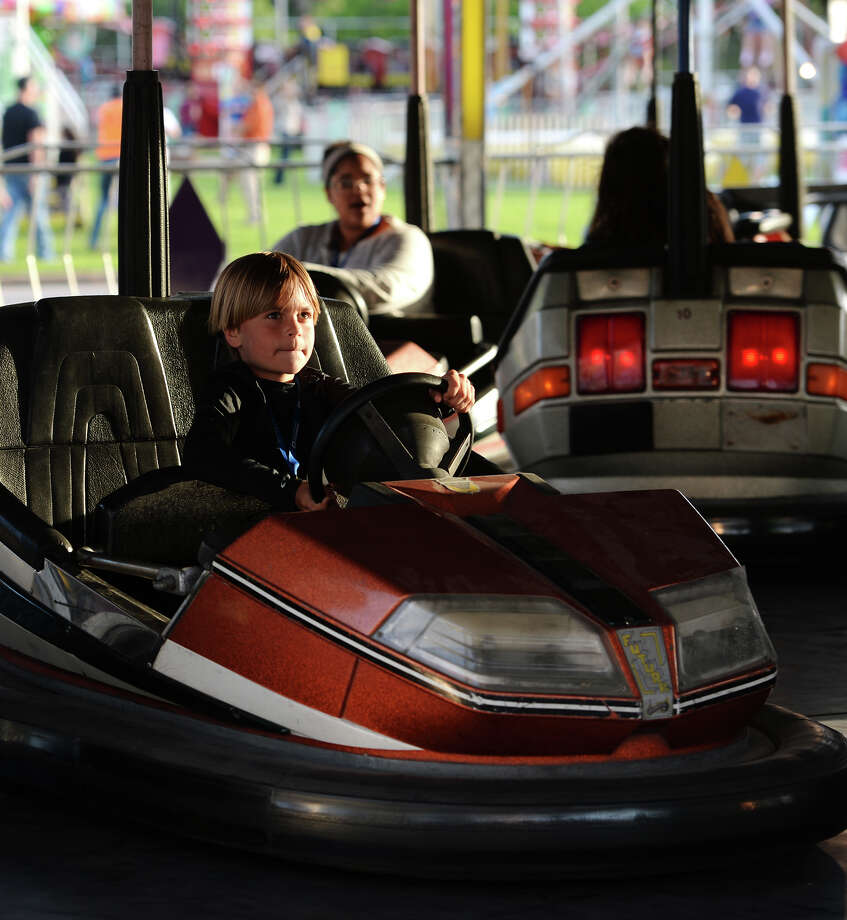 Children enjoy the rough and tumble fun of bumper cars during RiverFest's opening night Wednesday. Wednesday marked the first night of the Port Neches RiverFest. The first night was designated as Youth Night and featured Christian musical performances.