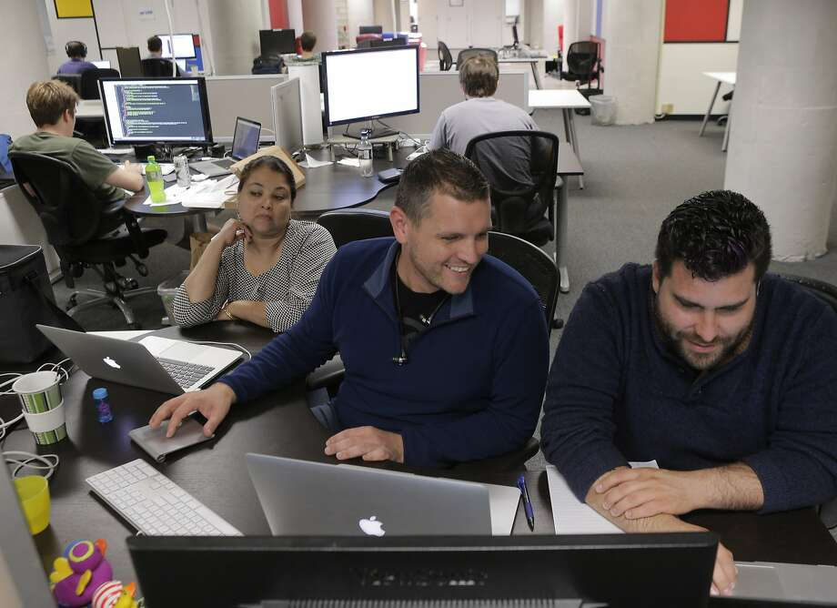 Alaka Cox (left), Allen Byerly and Gabriel Gonzales-Roybal work at Gyde, which can get health coverage through HackerCare. Photo: Carlos Avila Gonzalez, The Chronicle