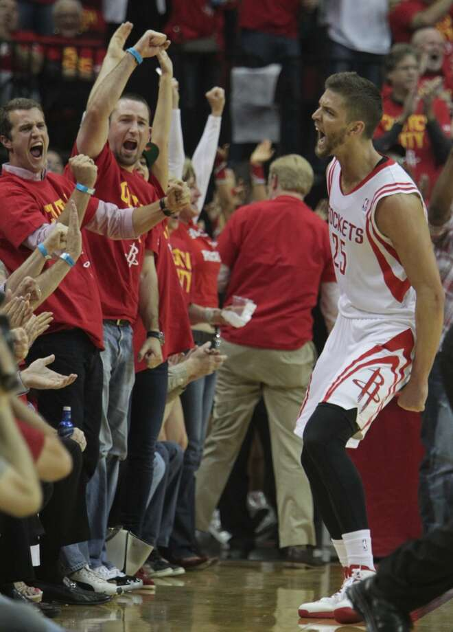 Rockets forward Chandler Parsons reacts after scoring a basket. Photo: James Nielsen, Houston Chronicle