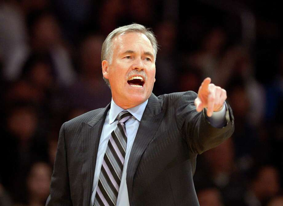 FILE - In this Feb. 28, 2014, file photo, Los Angeles Lakers head coach Mike D'Antoni gestures during the second half of an NBA basketball game against the Sacramento Kings in Los Angeles. Lakers spokesman John Black confirmed D'Antoni's resignation Wednesday, April 30. (AP Photo/Mark J. Terrill, File) Photo: Mark J. Terrill, STF / AP