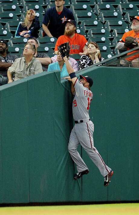 A good effort by Nationals left fielder Kevin Frandsen goes unrewarded as a foul ball by Alex Presley falls into the seats. Photo: Karen Warren, Staff / © 2014 Houston Chronicle