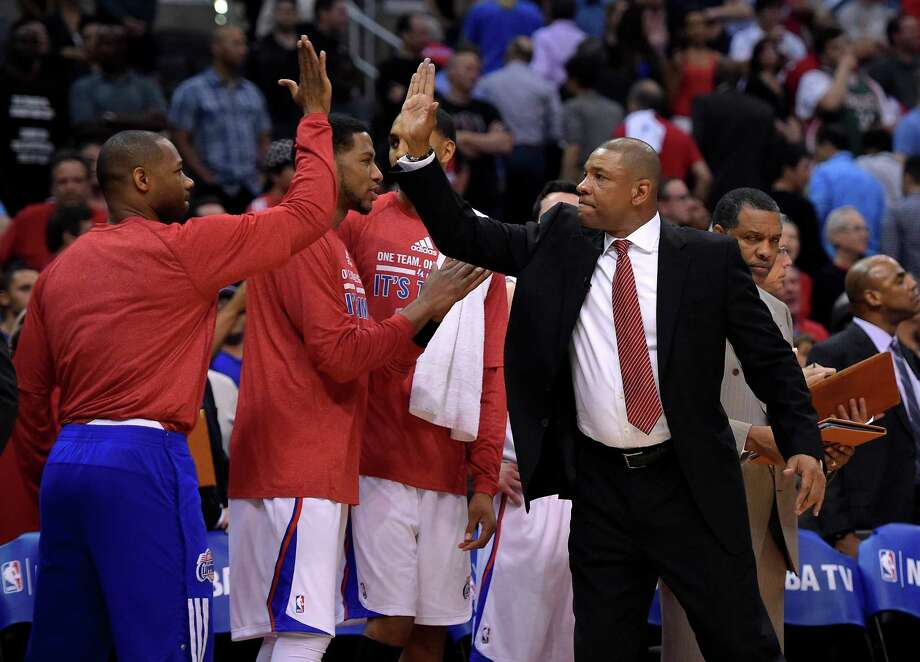 Clippers head coach Doc Rivers, right,  has done his best to keep his focus, and that of his players, on the task at hand - advancing in the NBA playoffs - rather than on the controversy surrounding the team's owner. Photo: STF / AP