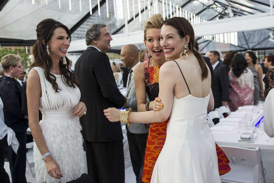 Nicole Curran, Rachael Bowman and Shannon Bavaro (left to right) chat with one another in the gala dinner tent while attending SFMOMA's Modern Ball at Yerba Buena Center for the Arts in San Francisco, Calif., on Wednesday, April 30 2014. Photo: Laura Morton, Special To The Chronicle