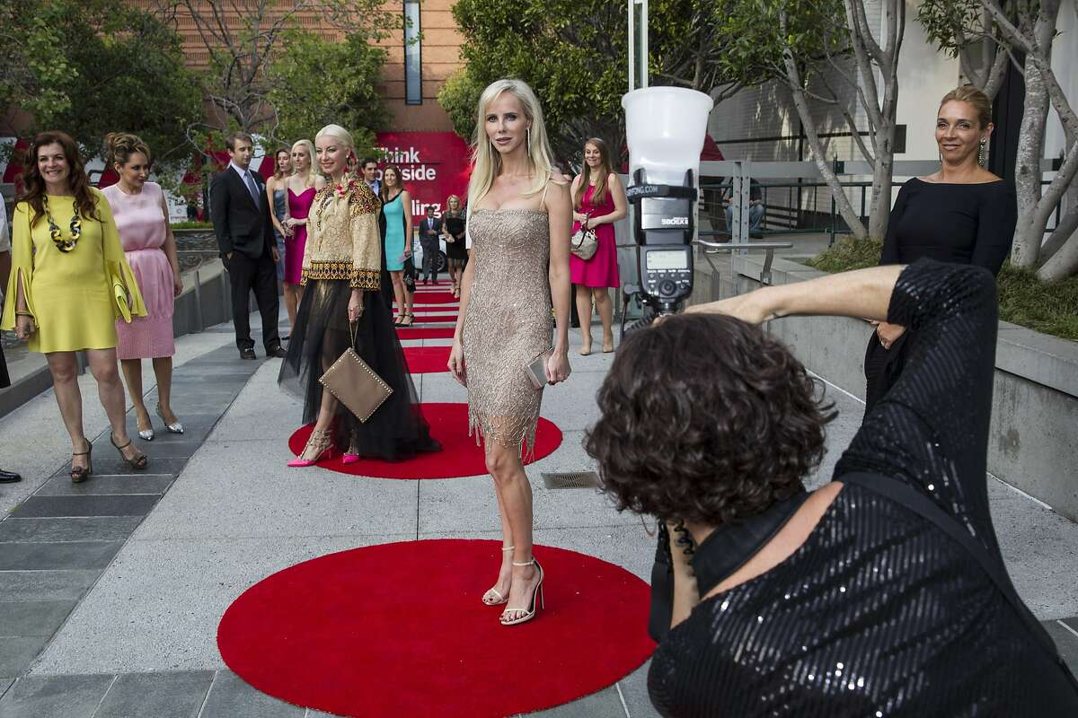 Vanessa Getty (center) poses for photographer Claudine Gossett after arriving to attend SFMOMA's Modern Ball at Yerba Buena Center for the Arts in San Francisco, Calif., on Wednesday, April 30 2014.