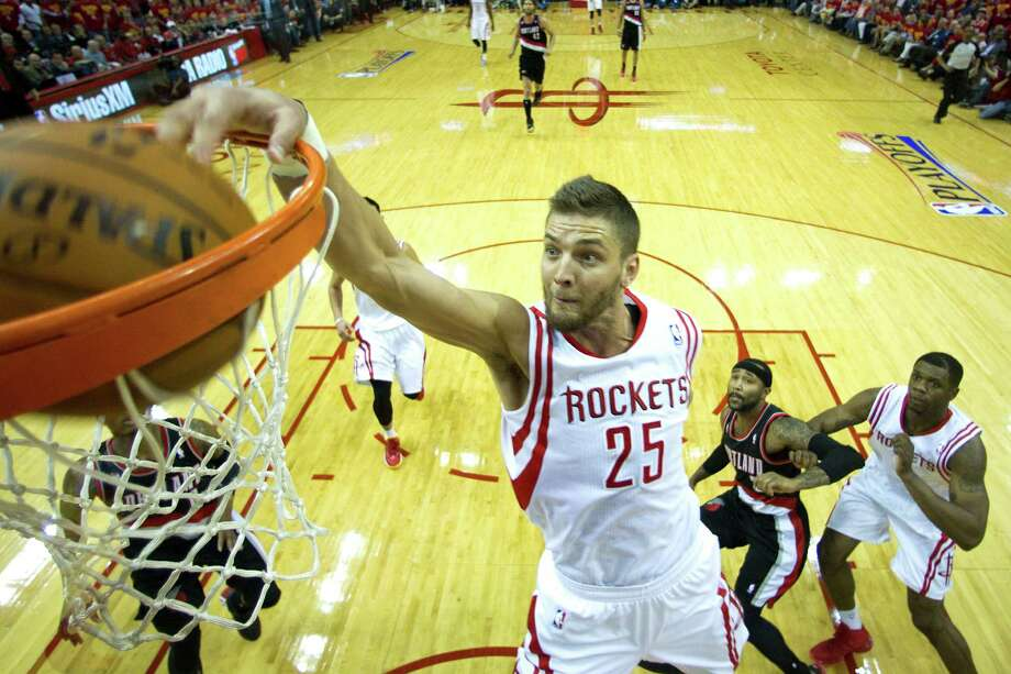 Rockets forward Chandler Parsons (25) gets two of his 20 points the easy way as the Rockets got off to a quick start Wednesday. Photo: Brett Coomer, Staff / © 2014 Houston Chronicle