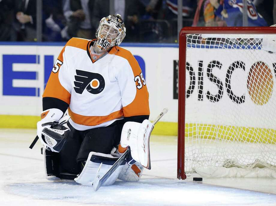 Flyers goalie Steve Mason is in disbelief after allowing a goal to the seldom-used Daniel Carcillo that started the Rangers on their way to a series-clinching win. Photo: Yong Kim, MBR / Philadelphia Daily News