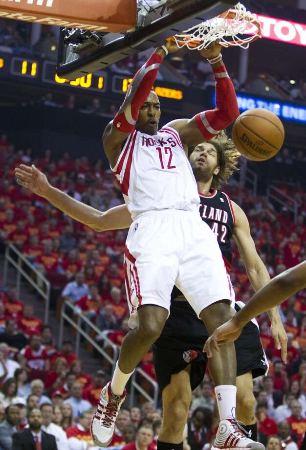 Rockets center Dwight Howard dunks. Photo: Brett Coomer, Houston Chronicle