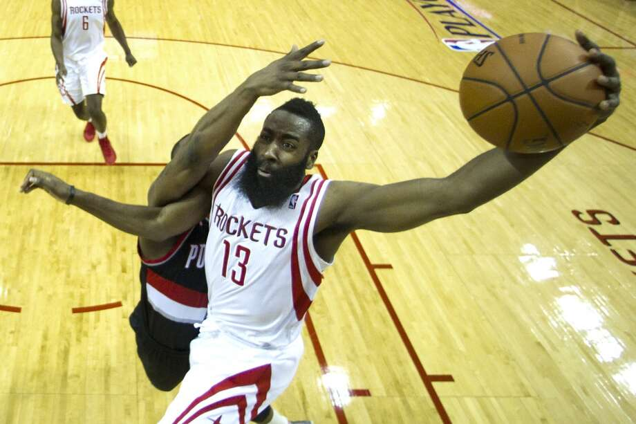 Rockets guard James Harden drives in for a shot against Trail Blazers guard Wesley Matthews. Photo: Brett Coomer, Houston Chronicle