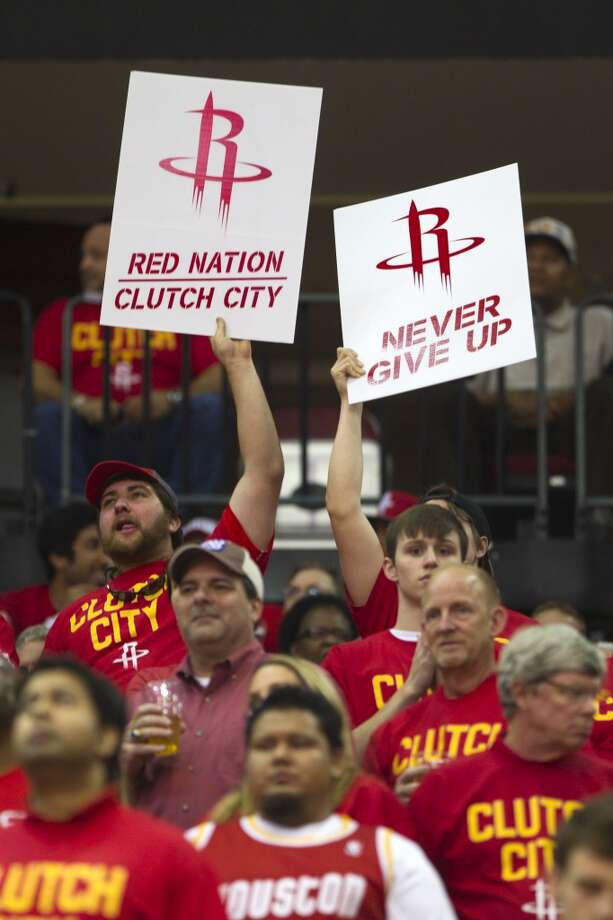 Rockets fans cheer during the second quarter. Photo: Brett Coomer, Houston Chronicle