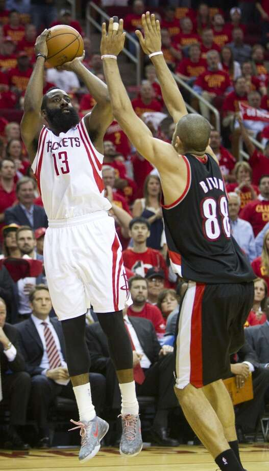 Rockets guard James Harden shoots over Trail Blazers forward Nicolas Batum. Photo: Brett Coomer, Houston Chronicle