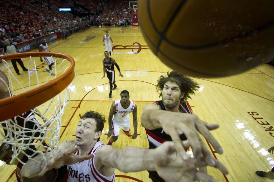 Trail Blazers center Robin Lopez blocks a shot by Rockets center Omer Asik. Photo: Brett Coomer, Houston Chronicle