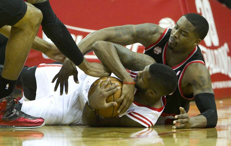 Rockets guard Troy Daniels and Trail Blazers guard Wesley Matthews go to the floor after chasing a loose ball. Photo: Brett Coomer, Houston Chronicle