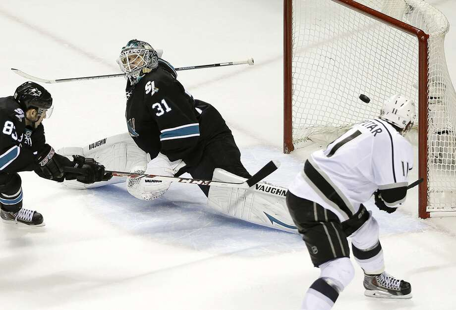 Los Angeles Kings center Anze Kopitar, of Slovenia, right, scores a goal past San Jose Sharks goalie Antti Niemi (31), of Finland, and left wing Matt Nieto (83) during the second period of Game 7 of an NHL hockey first-round playoff series in San Jose, Calif., Wednesday, April 30, 2014. (AP Photo) Photo: Associated Press