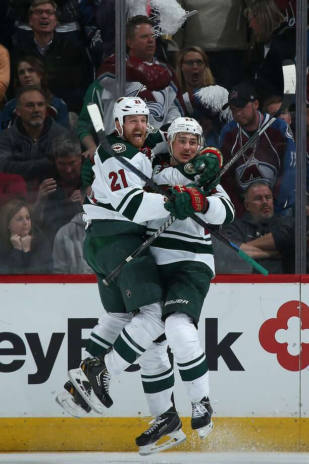 Minnesota's Nino Niederreiter (right) celebrates his winning goal with Kyle Brodziak. The Wild won 4-3 in overtime. Photo: Doug Pensinger, Getty Images