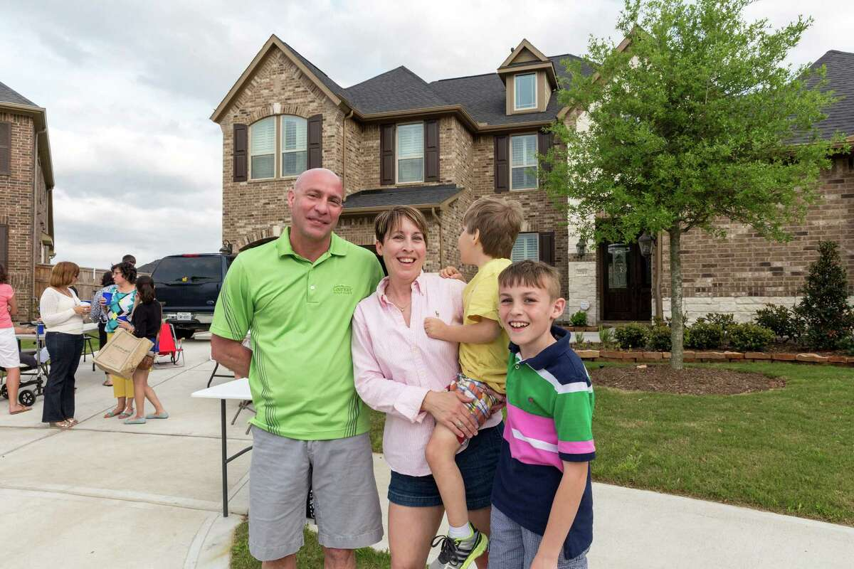 Parrish Braud, Michelle Braud, Connor Braud, 9, and Taylor Braud, 10, threw a block party for their new neighbors. Top seller Johnson Development's Cross Creek Ranch in Fulshear, Texas attracted many new home buyers to the Houston area. Saturday, April 12, 2014 (Craig H. Hartley/For the Chronicle)