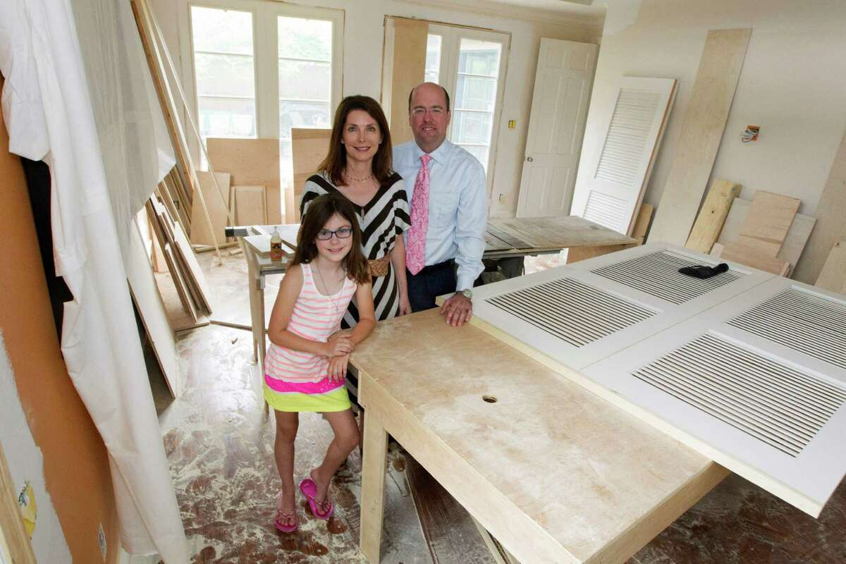 Katherine DeLaune and Lee Steely along with their daughter Ava, 9, pose for a portrait on Monday, April 21, 2014, in Houston. Their upper Kirby home is going through a major renovation. ( J. Patric Schneider / For the Chronicle )