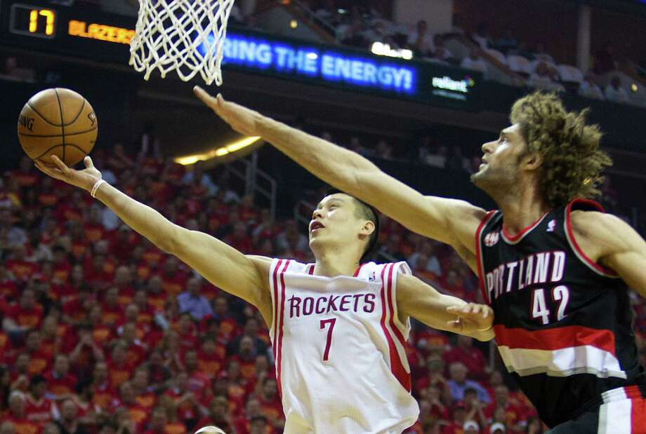 Guard Jeremy Lin, driving on Blazers center Robin Lopez, provided an offensive spark with 21 points and four assists Wednesday night. Photo: Brett Coomer, Staff / © 2014 Houston Chronicle