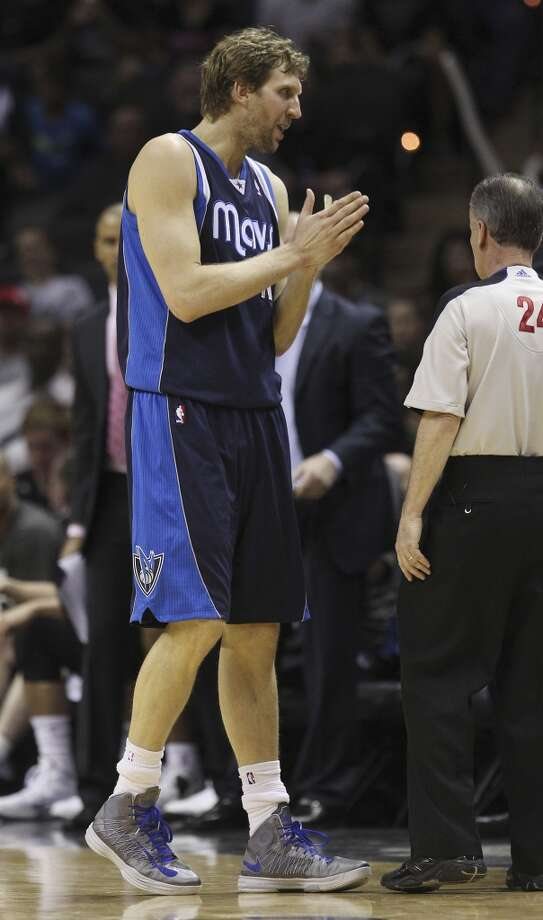 Dallas Mavericks' Dirk Nowitzki (41) pleads with a game official during the game against the Spurs in the second half of Game 5 of the first round of the Western Conference playoffs at the AT&T Center on Wednesday, Apr. 30, 2014. Spurs defeated the Mavericks, 109-103. (Kin Man Hui/San Antonio Express-News) Photo: San Antonio Express-News