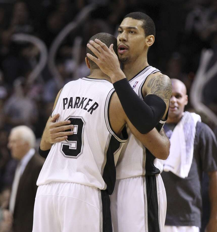 Spurs' Danny Green (04) gets a hug from Tony Parker (09) after a score against the Dallas Mavericks in the second half of Game 5 of the first round of the Western Conference playoffs at the AT&T Center on Wednesday, Apr. 30, 2014. Spurs defeated the Mavericks, 109-103. (Kin Man Hui/San Antonio Express-News) Photo: San Antonio Express-News