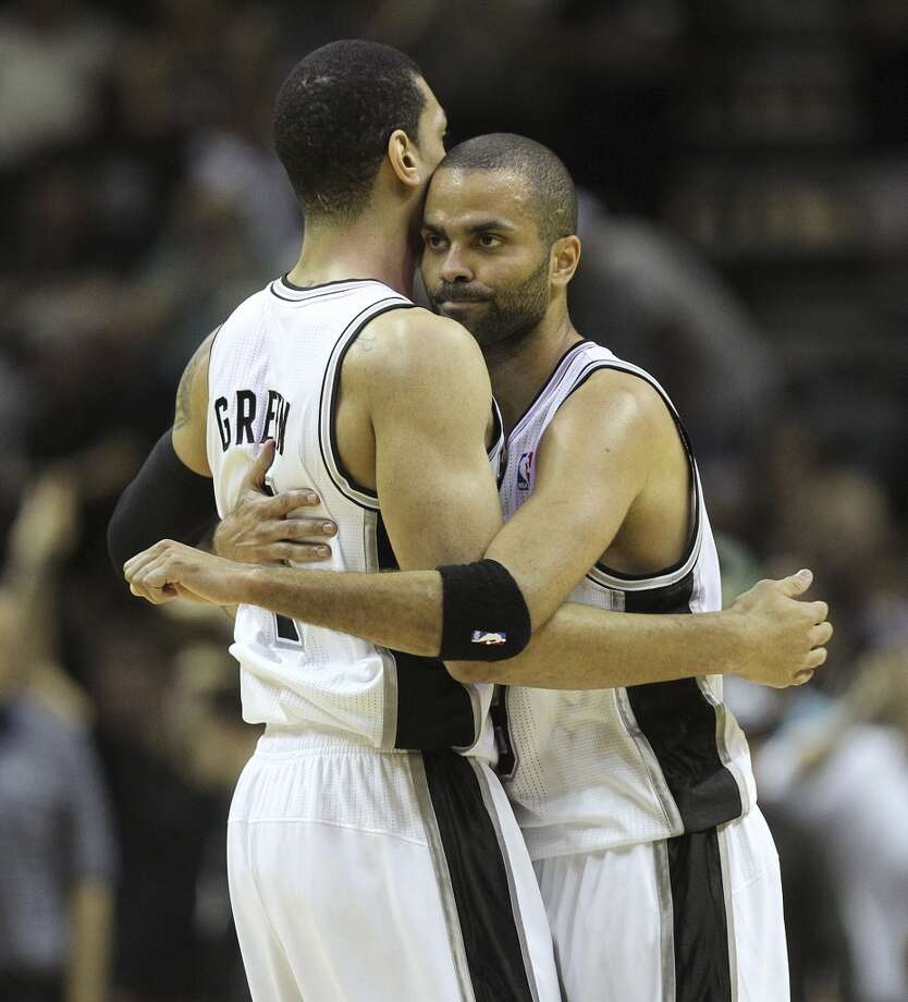 San Antonio Spurs' Tony Parker, right, hugs Danny Green during a break in the second half of game five in the first round of the Western Conference Playoffs against the Dallas Mavericks at the AT&T Center, Wednesday, April 30, 2014. The Spurs won 109-103 to lead the series, 3-2. Photo: San Antonio Express-News