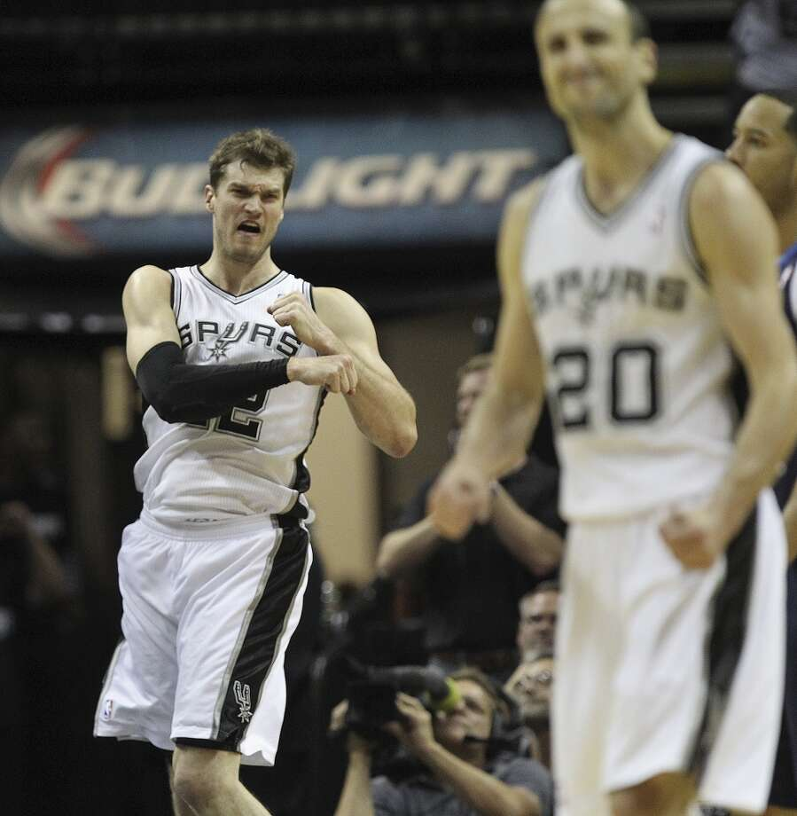 San Antonio Spurs' Tiago Splitter reacts after hitting a two-pointer during the second half of game five in the first round of the Western Conference Playoffs against the Dallas Mavericks at the AT&T Center, Wednesday, April 30, 2014. The Spurs won 109-103 to lead the series, 3-2. Photo: San Antonio Express-News