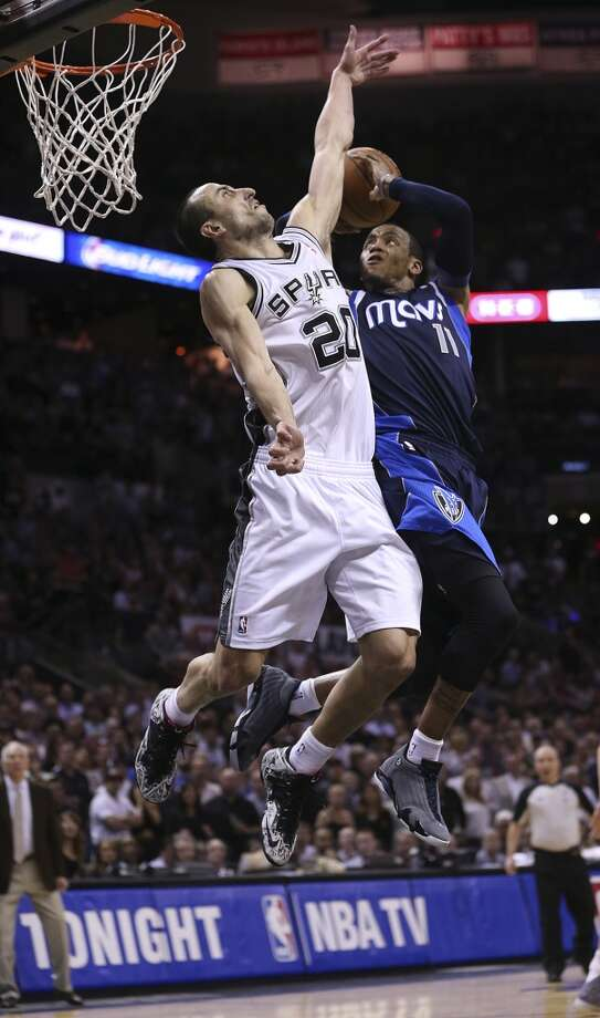 San Antonio Spurs' Manu Ginobili could Dallas Mavericks' Monta Ellis during the second half of game five in the first round of the Western Conference Playoffs at the AT&T Center, Wednesday, April 30, 2014. The Spurs won 109-103 to lead the series, 3-2. Photo: San Antonio Express-News
