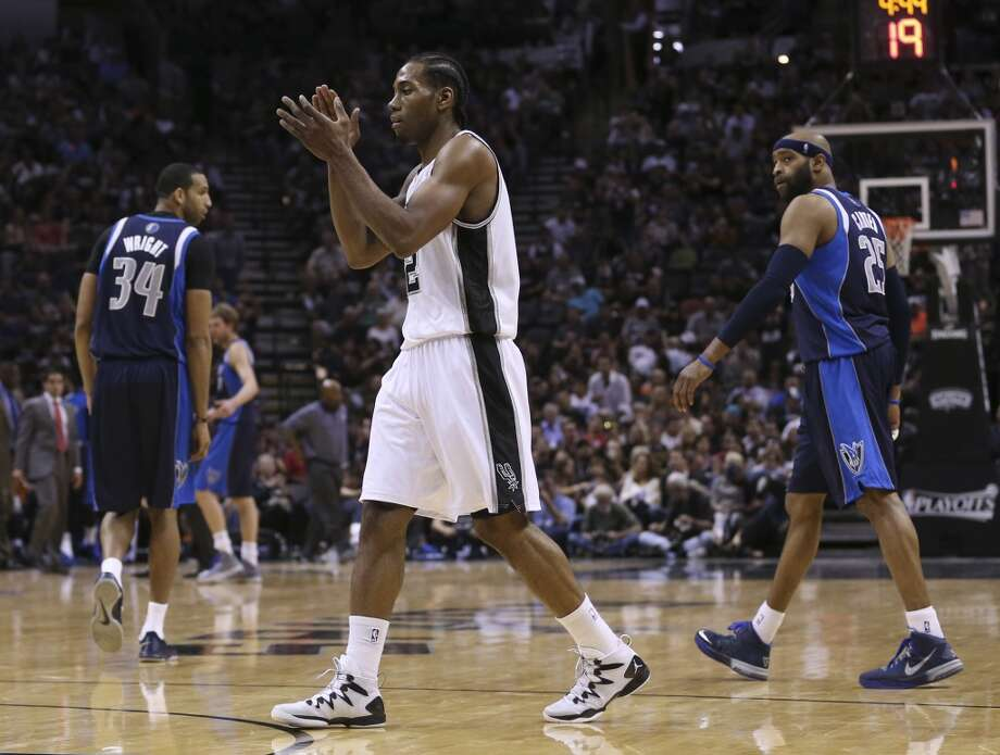 San Antonio Spurs' Kawhi Leonard reacts during a break in  the second half of game five of the first round of the Western Conference Playoffs at the AT&T Center, Wednesday, April 30, 2014. The Spurs won 109-103 to lead the series, 3-2. Photo: San Antonio Express-News