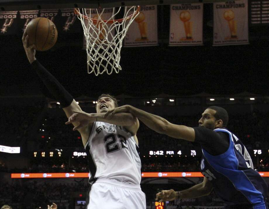 San Antonio Spurs' Tiago Splitter goes to the rim as Dallas Mavericks' Brandan Wright defends during the second half of game five in the first round of the Western Conference Playoffs at the AT&T Center, Wednesday, April 30, 2014. The Spurs won 109-103 to lead the series, 3-2. Photo: San Antonio Express-News