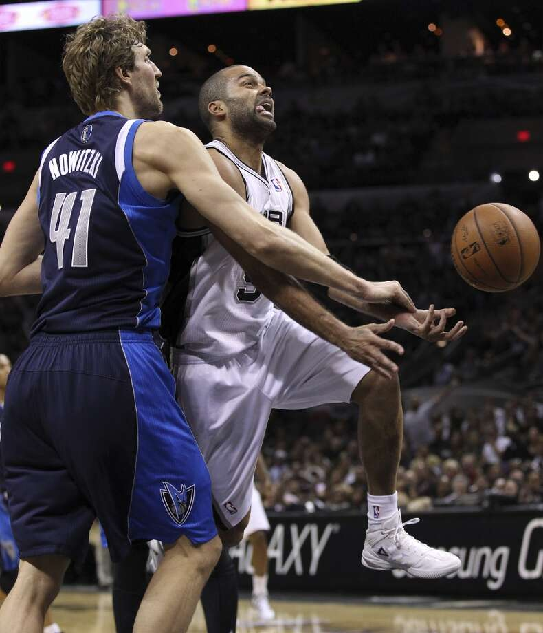 Spurs' Tony Parker (09) gets fouled by Dallas Mavericks' Dirk Nowitzki (41) in the second half of Game 5 of the first round of the Western Conference playoffs at the AT&T Center on Wednesday, Apr. 30, 2014. Spurs defeated the Mavericks, 109-103. (Kin Man Hui/San Antonio Express-News) Photo: San Antonio Express-News