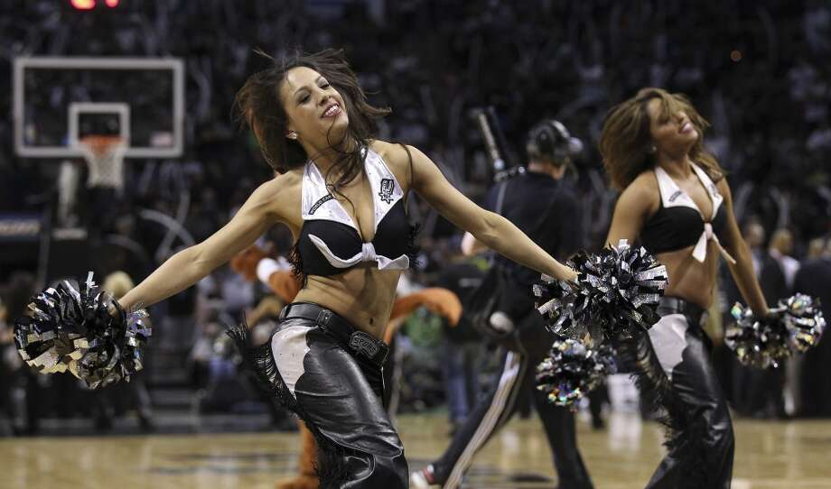 Spurs' Silverdancers perform during a timeout in the second half of Game 5 of the first round of the Western Conference playoffs at the AT&T Center on Wednesday, Apr. 30, 2014. Spurs defeated the Mavericks, 109-103. (Kin Man Hui/San Antonio Express-News) Photo: San Antonio Express-News