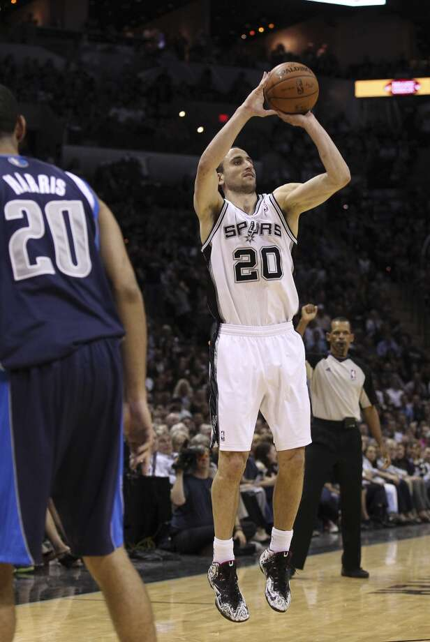 Spurs' Manu Ginobili (20) attempts a three-pointer in the second half of Game 5 of the first round of the Western Conference playoffs at the AT&T Center on Wednesday, Apr. 30, 2014. Spurs defeated the Mavericks, 109-103. (Kin Man Hui/San Antonio Express-News) Photo: San Antonio Express-News