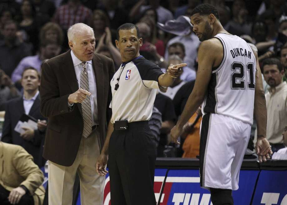 Spurs Head Coach Gregg Popovich converses with a game official in the second half of Game 5 of the first round of the Western Conference playoffs at the AT&T Center on Wednesday, Apr. 30, 2014. Spurs defeated the Mavericks, 109-103. (Kin Man Hui/San Antonio Express-News) Photo: San Antonio Express-News