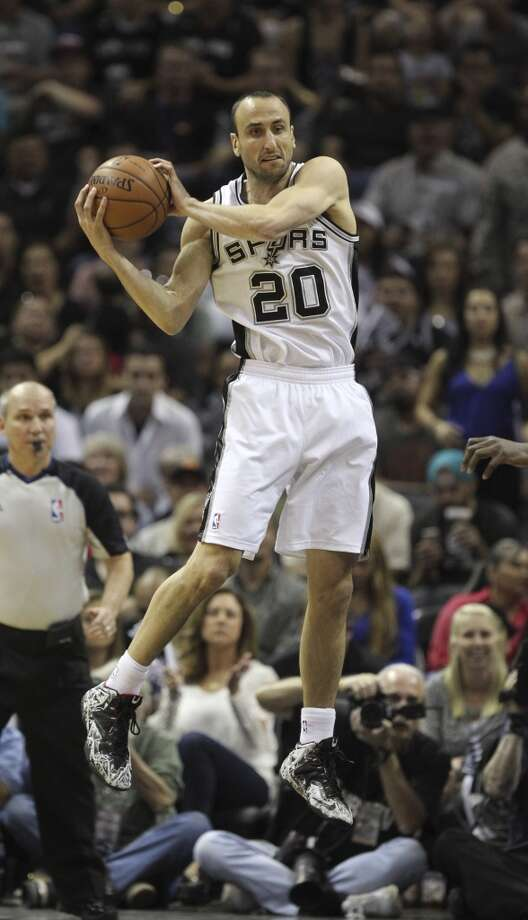 San Antonio Spurs' Manu Ginobili catches a high pass during the first half of game five in the first round of the Western Conference Playoffs against the Dallas Mavericks at the AT&T Center, Wednesday, April 30, 2014. Photo: San Antonio Express-News