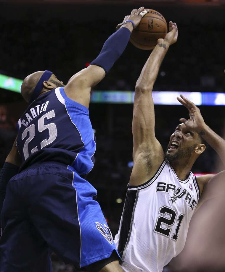 San Antonio Spurs' Tim Duncan is blocked by Dallas Mavericks' Vince Carter during the first half of game five in the first round of the Western Conference Playoffs at the AT&T Center, Wednesday, April 30, 2014. Photo: San Antonio Express-News