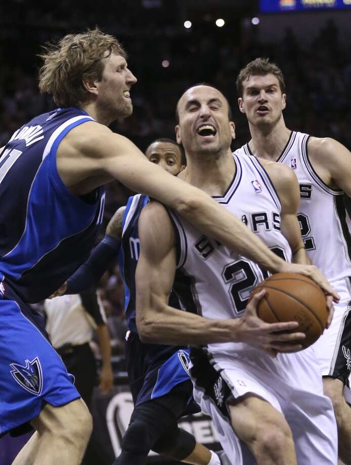 Dallas Mavericks' Dirk Nowitzki attempts to strip the ball from San Antonio Spurs' Manu Ginobili during the first half of game five in the first round of the Western Conference Playoffs at the AT&T Center, Wednesday, April 30, 2014. Photo: San Antonio Express-News