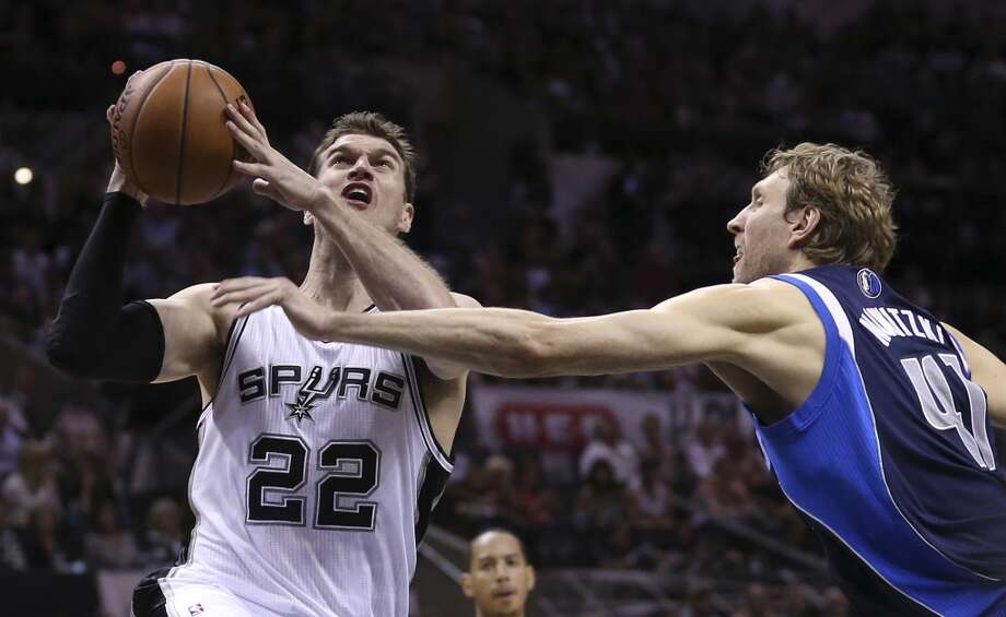 San Antonio Spurs' Tiago Splitter goes for two as Dallas Mavericks' Dirk Nowitzki defends during the first half of game five in the first round of the Western Conference Playoffs at the AT&T Center, Wednesday, April 30, 2014. Photo: San Antonio Express-News