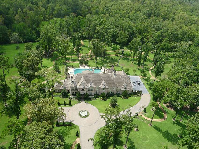 The Texas native's 10,582-square-foot, six-bedroom, 10-bath house has an expansive wine cellar, two-story wood-paneled library, theater and large motor court. Built in 2004, the house has a game room with a full bar and a shaded balcony that overlooks the property.