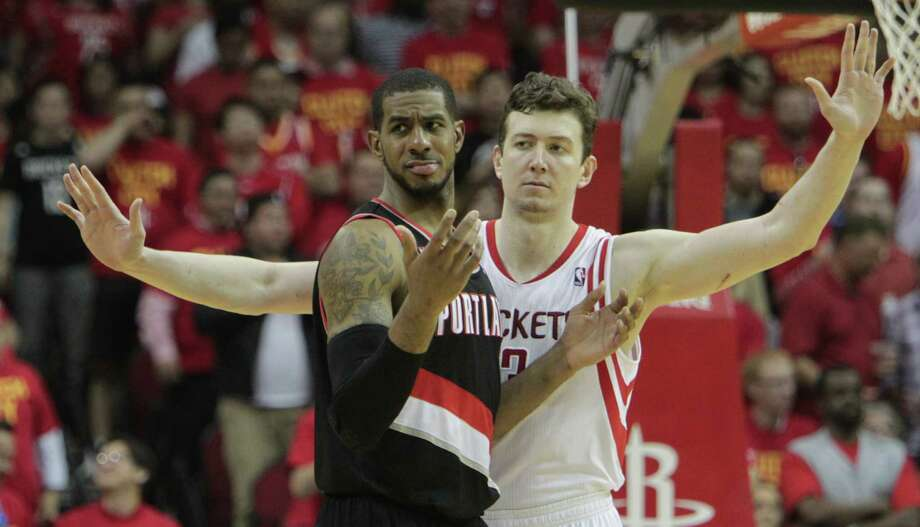 A terror in the series' first two games, LaMarcus Aldridge, left, couldn't overcome a team effort by Omer Asik & Co. as the Rockets staved off elimination Wednesday. Photo: James Nielsen, Staff / © 2014  Houston Chronicle
