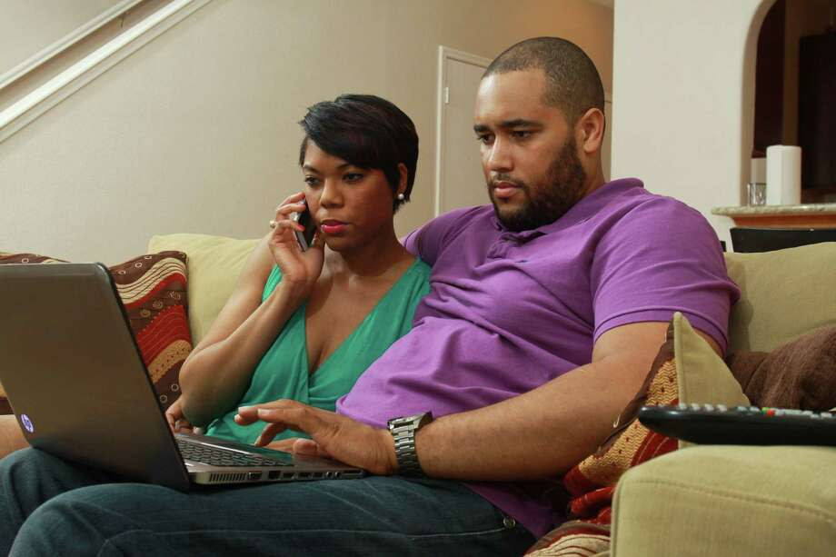 Shaunessy Bostic and her fiance, Jordan Riddick, started looking at houses about a month ago.  They say they don't want to be forced into making a hasty decision. Photo: Gary Fountain, Freelance / Copyright 2014 by Gary Fountain