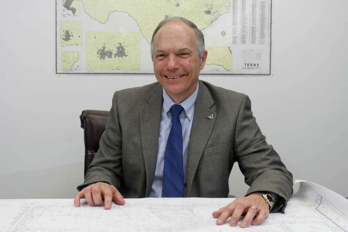 """W.F. """"Buddy"""" Trotter working with a site plan. Trotter is a senior appraisal reviewer for Houston-based O'Connor & Associates, and was installed as president of the Houston Chapter of the Appraisal Institute for 2014. (For the Chronicle/Gary Fountain, December 11, 2013)"""