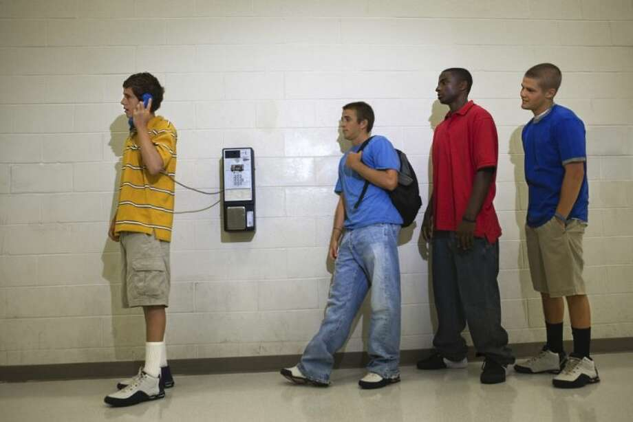 Call your mom for a ride home from a pay phone. Even better, wait in line to call your mom. Photo: Jupiter Images, Getty
