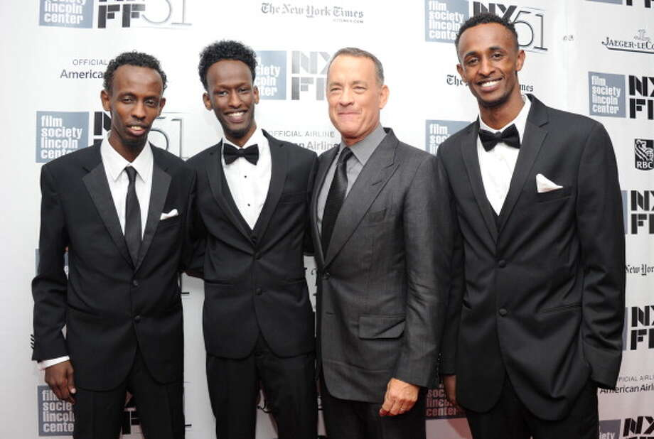 "Barkhad Abdi, Mahat M. Ali, Tom Hanks, and Faysal Ahmed attend the opening night gala world premiere of ""Captain Phillips"" during the 51st New York Film Festival at Alice Tully Hall at Lincoln Center on September 27, 2013 in New York City.  First-rate film, but it's a pressure cooker, and an airplane offers too many opportunities to break the tension. Photo: Jamie McCarthy, Getty Images / 2013 Getty Images"
