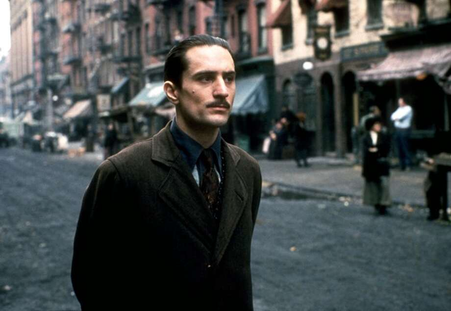 "Robert De Niro as Vito Corleone  in ""The Godfather Part II.""  Stick with Part I or Part III.  The start and stop nature of II, and some ambiguous plot elements, make this better for on-the-ground viewing. Photo: Paramount 1974"