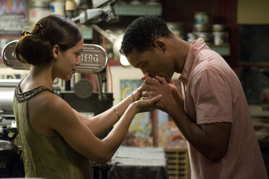 "Rosario Dawson and Will Smith in ""Seven Pounds.""  Multiple characters, moody, subtle -- not ideal for travel. Photo: Merrick Morton SMPSP, Sony Pictures 2008"